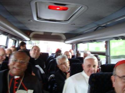 Pope Francis and the cardinals riding a bus today.