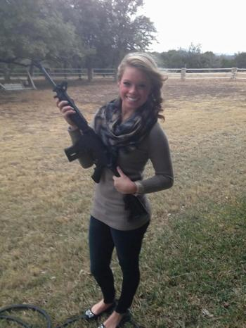 A chick packing heat is hot.