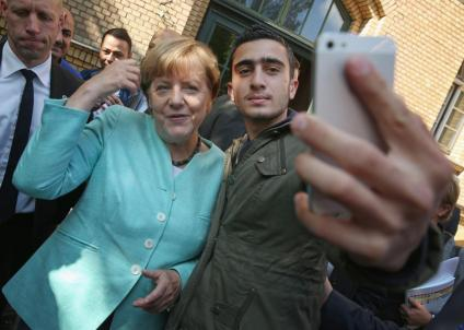 Angela Merkel gushing over her future Muslim masters...